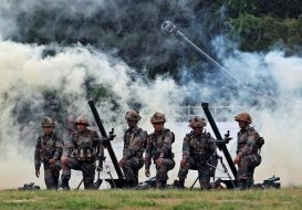 Indian Army soldiers participate in a war exercise during a two-day